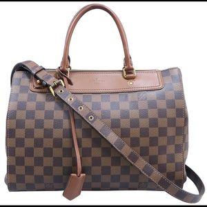 Louis Vuitton Greenwich- Multi-function handbag